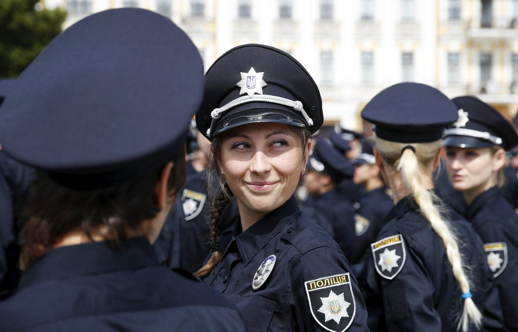 Police officers wait before an oath-taking ceremony to start up the work of a new police patrol service, part of the Interior Ministry reform initiated by Ukrainian authorities, in Kiev, Ukraine, July 4, 2015. The new service, which includes road, metro and foot patrols, is expected to replace the traffic police, widely associated with disrepute and corruption, according to local media. First 2.000 officers took an oath of allegiance to the Ukrainian people on Saturday. REUTERS/Valentyn Ogirenko