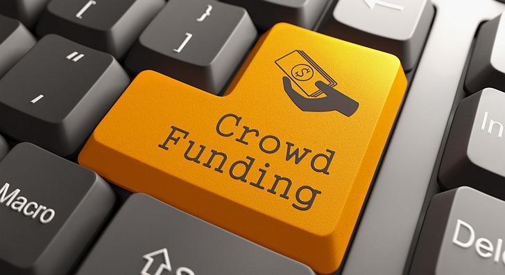 Orange Crowd Funding Button on Computer Keyboard. Internet Concept.